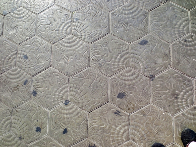 Be sure to look down when approaching the house. The tiles on the pavement were designed by Gaudi too!