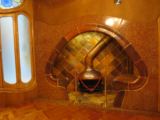 A small room with fireplace designed for a couple on one side and their chaperon on the other...
