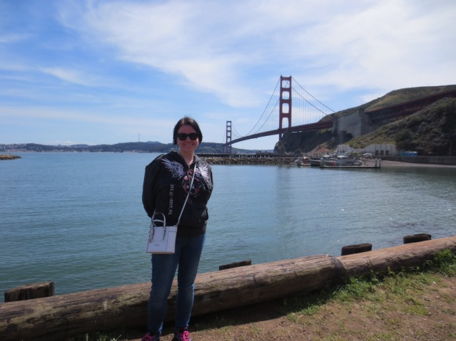 What happens when you get the guide to take a picture of you with the Golden Gate