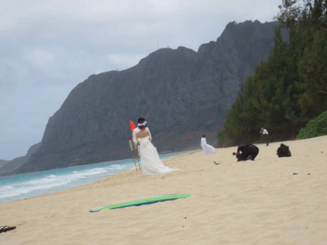 We saw FIVE couples taking their photos within one hour. Popular beach.