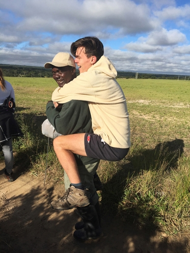 Matt riding a small elephant