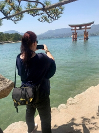 Jami capturing me capturing the torii
